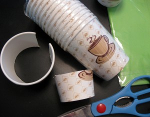 Paper or plastic cups, trimmed to size and ready to staple together.
