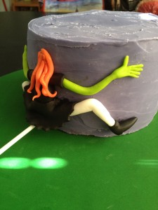 The bottom tier was covered in the purple ganache and had a witch planted into the front - she misjudged her landing.