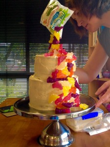 This is me placing some of the dinosaurs in clusters at the back of the cake, just so it's not bare for those who have a back-view.