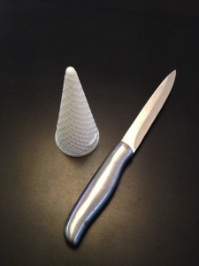 Start with a cone, not cup shaped ice-cream cone and a sharp, serrated knife (I used a steak knife)