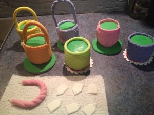 I covered all the baskets in different colours. You could choose a single colour or even use chocolate fondant, leaving the colour to come from the flowers, bows and eggs.