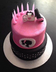 The finished cake, complete with sparkles, studs, shoes, bag and Barbie.