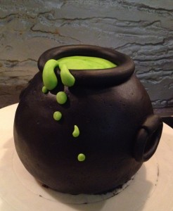 The top tier was a cauldron, filled with a gooey green potion.